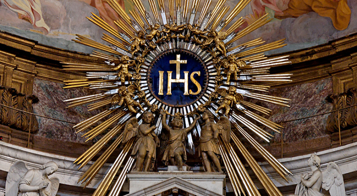 IHS monogram, on top of the main altar of the Gesù, Rome, Italy