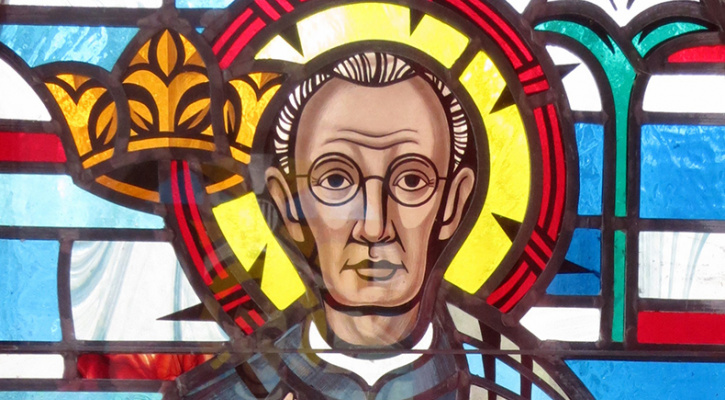 Stained glass window depicting 20th century martyr St. Maximilian Kolbe