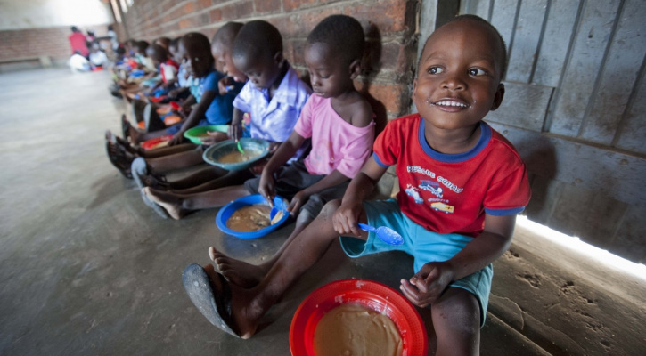Children are pictured in a file photo eating food provided by Mary's Meals at a center in Malawi. Pope Francis addressed the U.N. Food and Agriculture Organization Oct. 16, 2020, World Food Day. (CNS photo/courtesy Chris Watt)