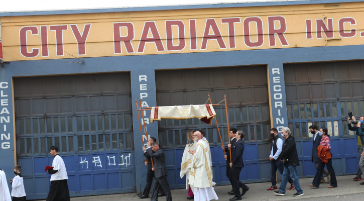 Archbishop Alexander K. Sample of Portland, Ore., carries the Eucharist and leads a process down the street Oct. 17, 2020, on the way to a rosary and exorcism ceremony for peace and justice in Portland. (CNS photo/Ed Langlois, Catholic Sentinel)