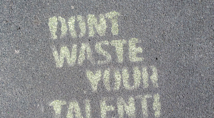 "Chalk message on sidewalk reading ""Don't Waste Your Talent""/Photo by Etienne Girardet on Unsplash"