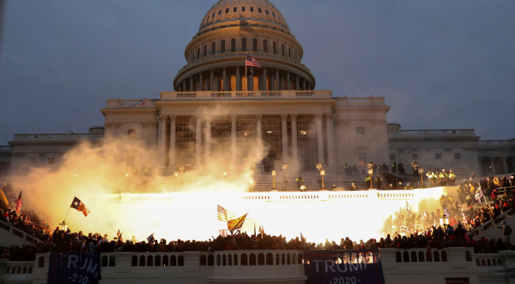 An explosion at the U.S. Capitol in Washington is caused by police munition while supporters of President Donald Trump breach the building Jan. 6, 2021. (CNS photo/Leah Millis, Reuters)