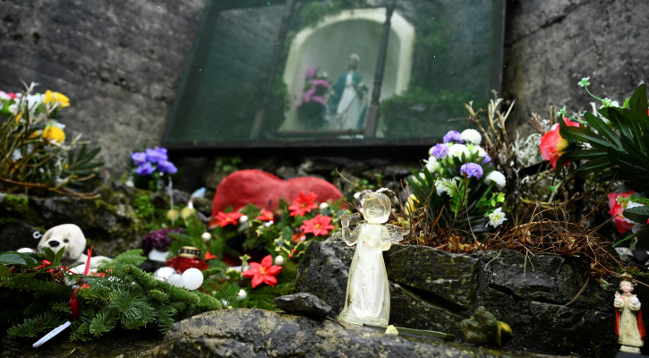 IRELAND BABIES UNMARRIED MOTHERS An angel and statue of Mary are pictured at a cemetery in Tuam, Ireland, where the bodies of nearly 800 infants were uncovered at the site of a former Catholic home for unmarried mothers and their children. The photo was taken Jan. 12, 2021, the day a commission investigating the treatment of women in such homes released its report. (CNS photo/Clodagh Kilcoyne, Reuters)