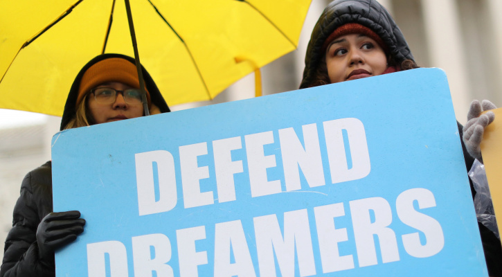 Demonstrators in support of DACA hold signs outside the U.S. Supreme Court in Washington Nov. 12, 2019. U.S. President Joe Biden Jan. 20, 2021, revoked Trump's 2017 executive order that authorized massive expansion of immigration enforcement in U.S. and implemented 100-day moratorium on certain deportations. (CNS photo/Jonathan Ernst, Reuters)