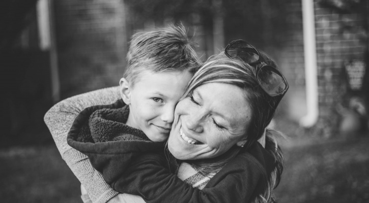 Mom and son hugging/Photo by Connor Wilkins on Unsplash