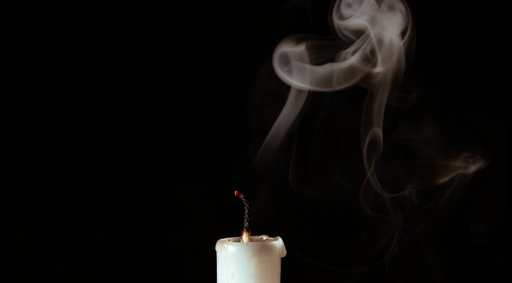 Photo by Luciano Stegun of a blown out candle. Minute Meditations.