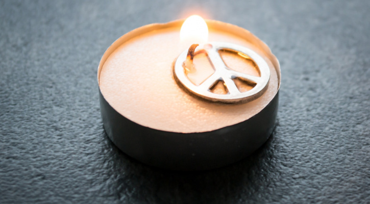 candle with peace sign/Photo by Steve Johnson from Pexels